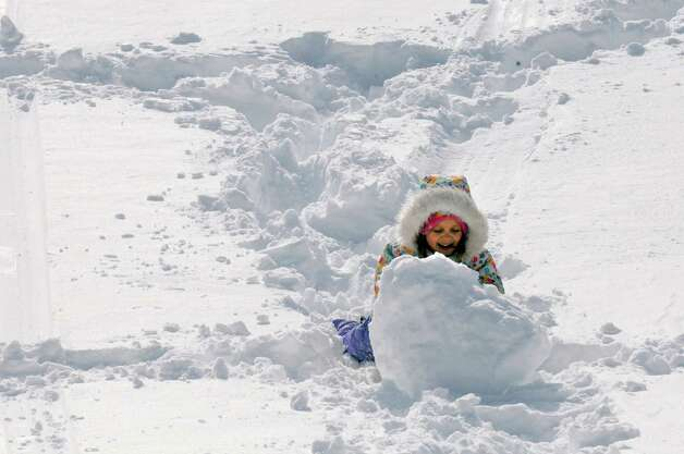 Six-year-old Anya Miller of Albany plays in the snow at Lincoln Park Friday, Feb. 14, 2014, in Albany, N.Y. (Michael P. Farrell/Times Union) Photo: Michael P. Farrell / 00025756A