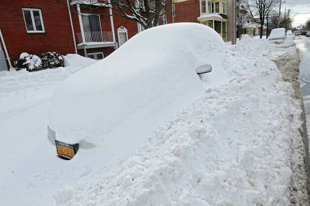 A car parked along Delaware Ave. is completely covered in snow after a major snowstorm Friday, Feb. 14, 2014, in Albany, N.Y.  (Lori Van Buren / Times Union) Photo: Lori Van Buren / 0025756A
