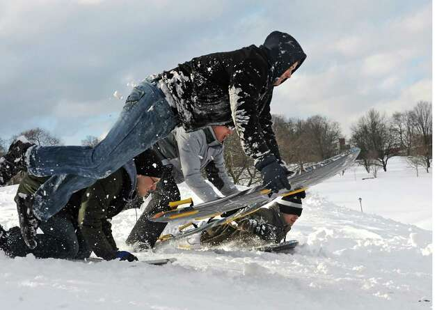 A group of young men take off down a hill on sleds at Lincoln Park Friday, Feb. 14, 2014, in Albany, N.Y.  (Lori Van Buren / Times Union) Photo: Lori Van Buren / 0025756A