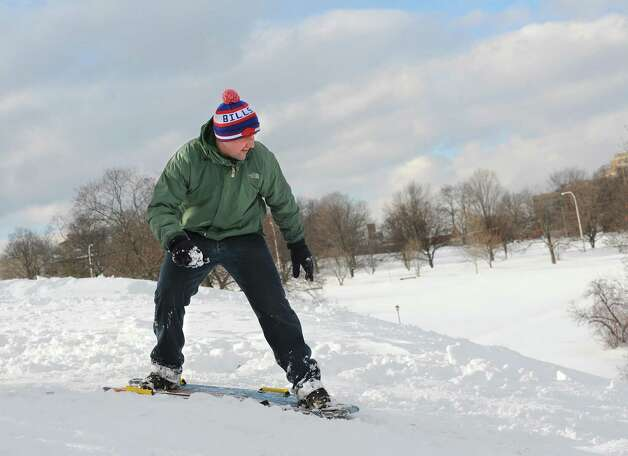 Joe Gordman of Latham snowboards down a hill at Lincoln Park after a major snow storm Friday, Feb. 14, 2014 in Albany, N.Y.  (Lori Van Buren / Times Union) Photo: Lori Van Buren / 0025756A