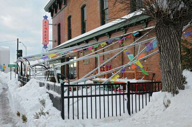 The awning frame from the outdoor dining area is seen collapsed at Bombers after a major snowstorm Friday, Feb. 14, 2014, in Troy, N.Y.  (Lori Van Buren / Times Union) Photo: Lori Van Buren / 0025756A