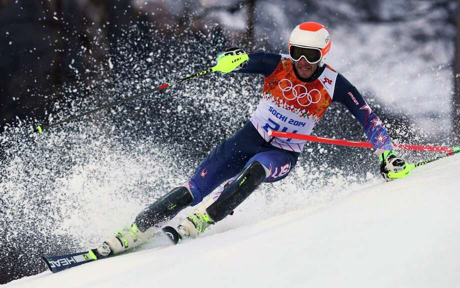 United States' Bode Miller makes a turn during the slalom portion of the men's supercombined at the Sochi 2014 Winter Olympics, Friday, Feb. 14, 2014, in Krasnaya Polyana, Russia. (AP Photo/Alessandro Trovati) ORG XMIT: OLYAL299 Photo: Alessandro Trovati / AP