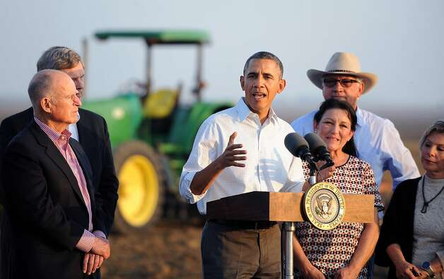 President Obama addresses the seriousness of the drought as he speaks to the media with Gov. Jerry Brown (left) and farmers Joe and Maria Del Bosque in Los Banos (Merced County). Photo: Wally Skalij, Associated Press