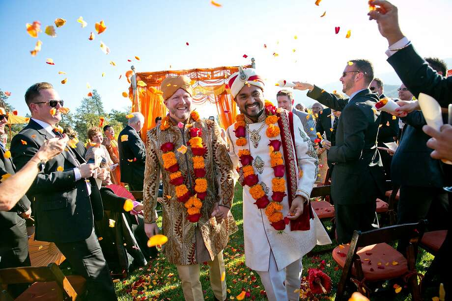 For their wedding in Glen Ellen, grooms Matt Hicks and Harshal Sanghavi exchanged vows outdoors under a canopy while wearing traditional Indian sherwanis. Photo: Arrowood Photography
