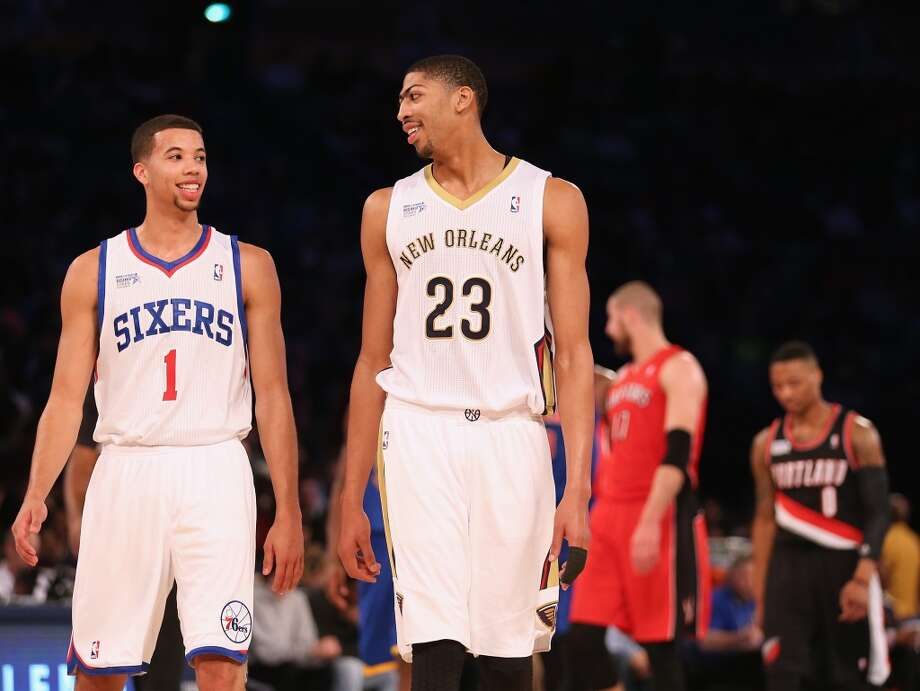 NEW ORLEANS, LA - FEBRUARY 14:  Team Webber's Michael Carter-Williams #1 of the Phildelphia 76ers and Anthony Davis #23 of the New Orleans Pelicans talk during a time out in the first half against Team Hill during the BBVA Compass Rising Stars Challenge 2014 as part of the 2014 NBA Allstar Weekend at the Smoothie King Center on February 14, 2014 in New Orleans, Louisiana. NOTE TO USER: User expressly acknowledges and agrees that, by downloading and or using this photograph, User is consenting to the terms and conditions of the Getty Images License Agreement.  (Photo by Christian Petersen/Getty Images) Photo: Christian Petersen, Getty Images
