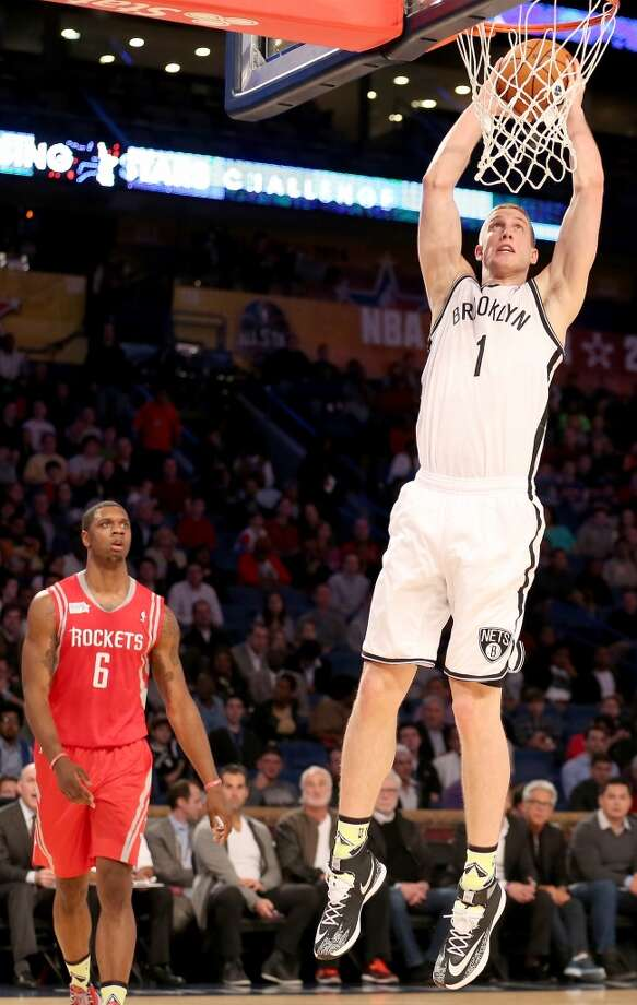 NEW ORLEANS, LA - FEBRUARY 14:  Team Webber's Mason Plumlee #1 of the Brooklyn Nets takes a shot as Team Hill's Terrence Jones #6 of the Houston Rockets defends during the BBVA Compass Rising Stars Challenge 2014 as part of the 2014 NBA Allstar Weekend at the Smoothie King Center on February 14, 2014 in New Orleans, Louisiana. NOTE TO USER: User expressly acknowledges and agrees that, by downloading and or using this photograph, User is consenting to the terms and conditions of the Getty Images License Agreement.  (Photo by Christian Petersen/Getty Images) Photo: Christian Petersen, Getty Images