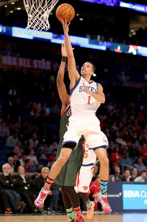 NEW ORLEANS, LA - FEBRUARY 14:  Team Webber's Michael Carter-Williams #1 of the Philadelphia 76ers takes a shot as Team Hill's Giannis Antetokounmpo #34 of the Milwaukee Bucks defends during the BBVA Compass Rising Stars Challenge 2014 as part of the 2014 NBA Allstar Weekend at the Smoothie King Center on February 14, 2014 in New Orleans, Louisiana. NOTE TO USER: User expressly acknowledges and agrees that, by downloading and or using this photograph, User is consenting to the terms and conditions of the Getty Images License Agreement.  (Photo by Christian Petersen/Getty Images) Photo: Christian Petersen, Getty Images