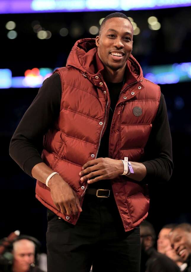 NEW ORLEANS, LA - FEBRUARY 14:  Dwight Howard of the Houston Rockets watches the BBVA Compass Rising Stars Challenge 2014 game as part of the 2014 NBA Allstar Weekend at the Smoothie King Center on February 14, 2014 in New Orleans, Louisiana. NOTE TO USER: User expressly acknowledges and agrees that, by downloading and or using this photograph, User is consenting to the terms and conditions of the Getty Images License Agreement.  (Photo by Christian Petersen/Getty Images) Photo: Christian Petersen, Getty Images