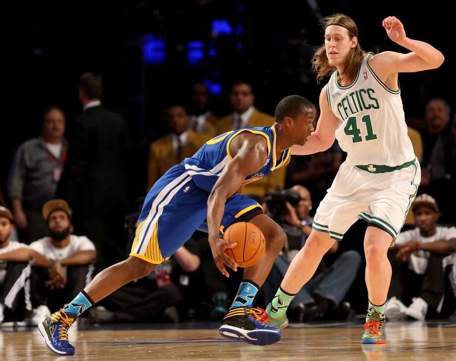 NEW ORLEANS, LA - FEBRUARY 14:  Team Hill's Harrison Barnes #40 of the Golden State Warriors drives as Team Webber's Kelly Olynyk #41 of the Boston Celtics defends during the BBVA Compass Rising Stars Challenge 2014 as part of the 2014 NBA Allstar Weekend at the Smoothie King Center on February 14, 2014 in New Orleans, Louisiana. NOTE TO USER: User expressly acknowledges and agrees that, by downloading and or using this photograph, User is consenting to the terms and conditions of the Getty Images License Agreement.  (Photo by Christian Petersen/Getty Images) Photo: Christian Petersen, Getty Images