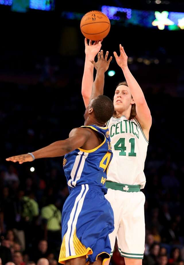 NEW ORLEANS, LA - FEBRUARY 14:  Team Webber's Kelly Olynyk #41 of the Boston Celtics takes a shot as Team Hill's Harrison Barnes #40 of the Golden State Warriors defends during the BBVA Compass Rising Stars Challenge 2014 as part of the 2014 NBA Allstar Weekend at the Smoothie King Center on February 14, 2014 in New Orleans, Louisiana. NOTE TO USER: User expressly acknowledges and agrees that, by downloading and or using this photograph, User is consenting to the terms and conditions of the Getty Images License Agreement.  (Photo by Christian Petersen/Getty Images) Photo: Christian Petersen, Getty Images
