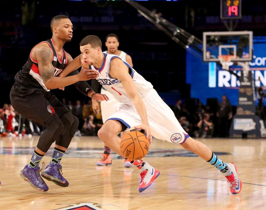 NEW ORLEANS, LA - FEBRUARY 14:  Team Webber's Michael Carter-Williams #1 of the Philadelphia 76ers drives as Team Hill's Damian Lillard #0 of the Portland Trail Blazers defends during the BBVA Compass Rising Stars Challenge 2014 as part of the 2014 NBA Allstar Weekend at the Smoothie King Center on February 14, 2014 in New Orleans, Louisiana. NOTE TO USER: User expressly acknowledges and agrees that, by downloading and or using this photograph, User is consenting to the terms and conditions of the Getty Images License Agreement.  (Photo by Christian Petersen/Getty Images) Photo: Christian Petersen, Getty Images