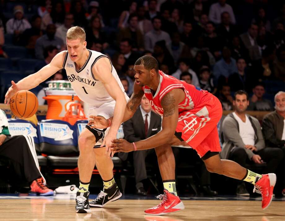 NEW ORLEANS, LA - FEBRUARY 14:  Team Webber's Mason Plumlee #1 of the Brooklyn Nets tries to keep the ball from Team Hill's Terrence Jones #6 of the Houston Rockets during the BBVA Compass Rising Stars Challenge 2014 as part of the 2014 NBA Allstar Weekend at the Smoothie King Center on February 14, 2014 in New Orleans, Louisiana. NOTE TO USER: User expressly acknowledges and agrees that, by downloading and or using this photograph, User is consenting to the terms and conditions of the Getty Images License Agreement.  (Photo by Christian Petersen/Getty Images) Photo: Christian Petersen, Getty Images