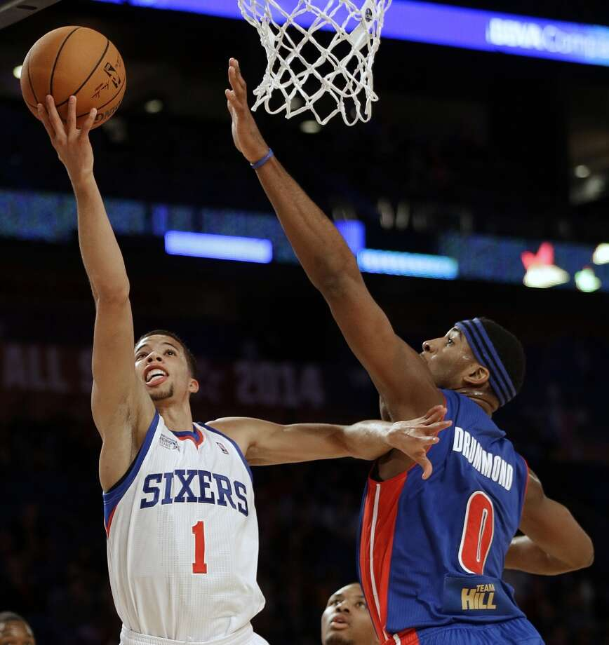 CORRECTS PLAYER AT LEFT TO MICHAEL CARTER-WILLIAMS, INSTEAD OF MASON PLUMLEE - Team Webber's Michael Carter-Williams of the Philadelphia 76ers shoots against Team Hill's Andre Drummond of the Detroit Pistons during the Rising Star NBA All Star Challenge Basketball game, Friday, Feb. 14, 2014, in New Orleans. (AP Photo/Gerald Herbert) Photo: Gerald Herbert, Associated Press