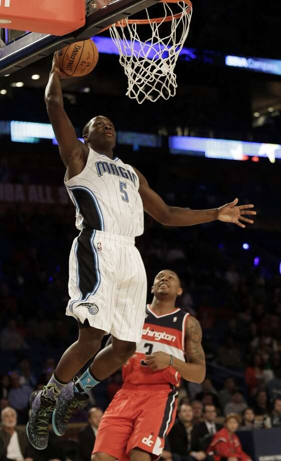 CORRECTS ID OF PLAYER AT REAR TO BRADLEY BEAL, INSTEAD OF DION WAITERS - Team Webber's Victor Oladipo of the Orlando Magic shoots against Team Hill's Bradley Beal of the Washington Wizards during the Rising Star NBA All Star Challenge basketball game, Friday, Feb. 14, 2014, in New Orleans. (AP Photo/Gerald Herbert) Photo: Gerald Herbert, Associated Press