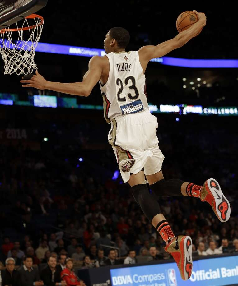 Team Webber's Anthony Davis of the New Orleans Pelicans heads to the basket against Team Hill during the Rising Star NBA All Star Challenge Basketball game, Friday, Feb. 14, 2014, in New Orleans. (AP Photo/Gerald Herbert) Photo: Gerald Herbert, Associated Press