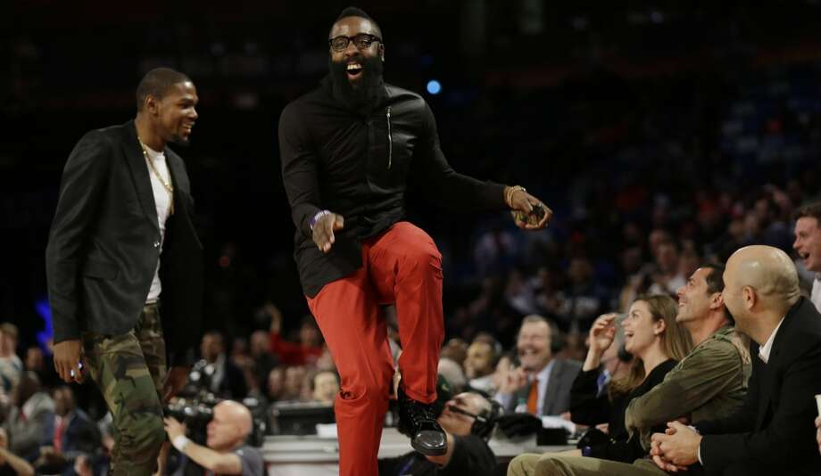 Houston Rockets James Harden, right, dances with Oklahoma City Thunder Kevin Durant during the Rising Star NBA All Star Challenge Basketball game, Friday, Feb. 14, 2014, in New Orleans. (AP Photo/Gerald Herbert) Photo: Gerald Herbert, Associated Press