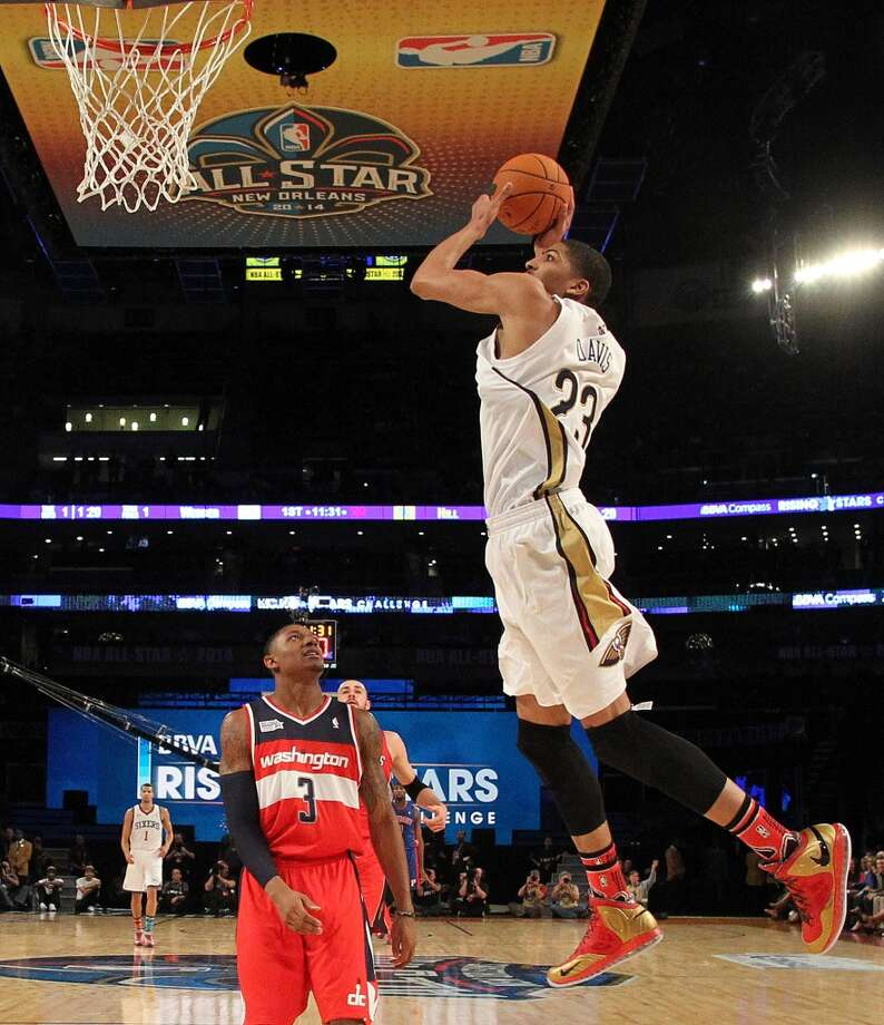 Team Webber's Anthony Davis of the New Orleans Pelicans heads to the basket as Team Hill's Bradley Beal of the Washington Capitals look son during the Rising Star NBA All Star Challenge Basketball game,, Friday, Feb. 14, 2014, in New Orleans. (AP Photo/Bob Donnan, Pool) Photo: Bob Donnan, Associated Press