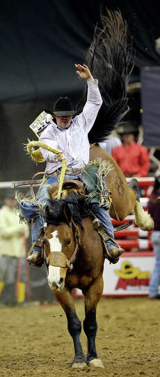 Cody Martin, of Eagle, CO, competes in the saddle bronc riding event during the San Antonio Stock Sh