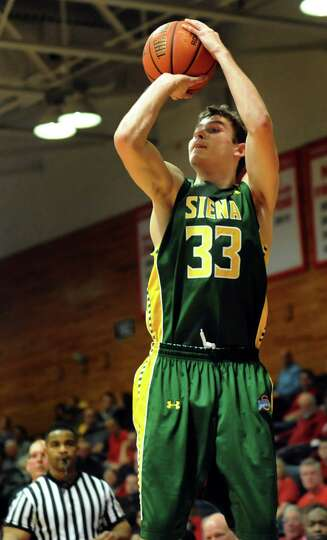 Siena's Rob Poole shoots for three during their basketball game against Marist on Friday, Feb. 14, 2