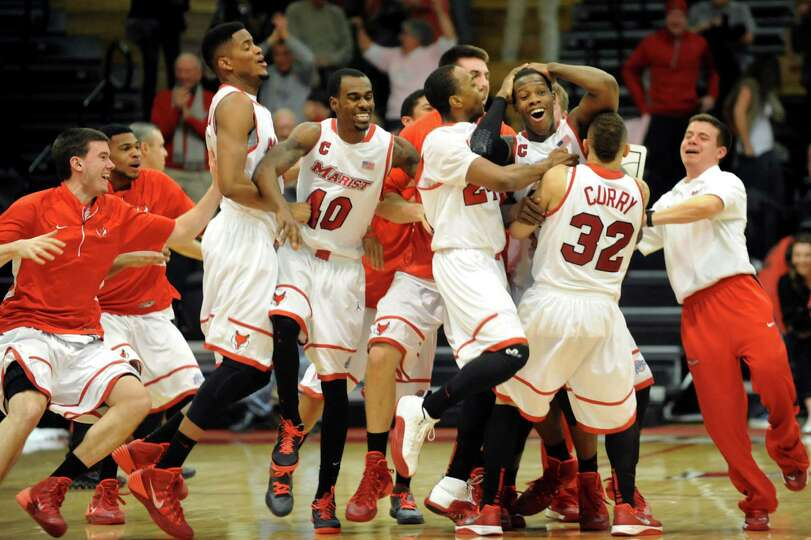 Pandemonium breaks out when Marist hits the buzzer beater to win 65-64 over Siena in their basketbal