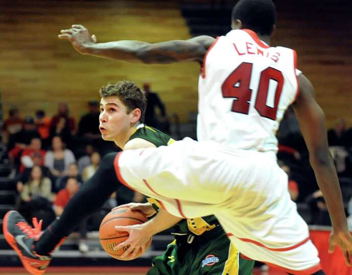 Siena's Rob Poole, left, looks to get past Marist's Chavaughn Lewis during their basketball game on