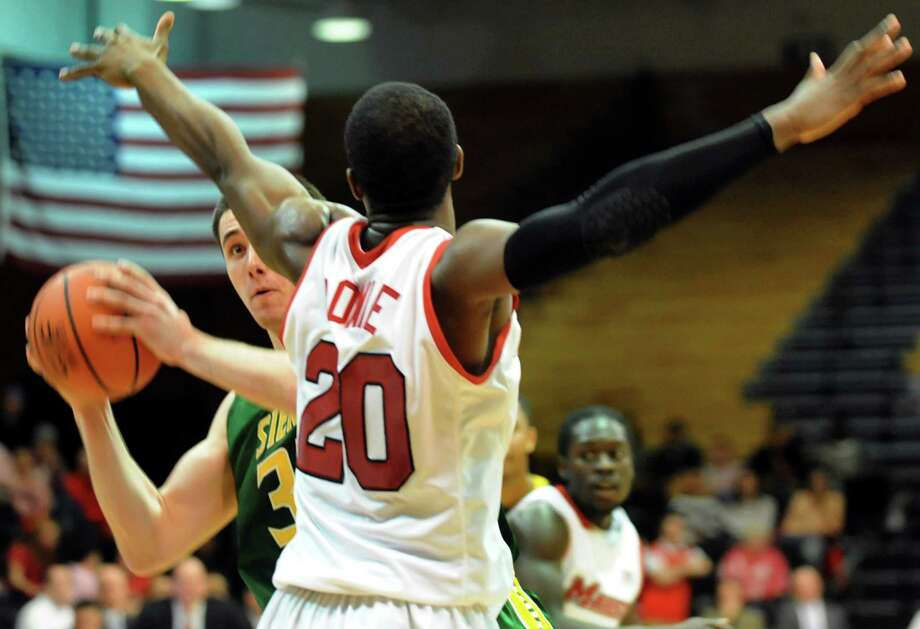 Siena's Brett Bisping, left, looks to pass as Marist's Jay Bowie defends during their basketball game on Friday, Feb. 14, 2014, at McCann Arena in Poughkeepsie, N.Y. (Cindy Schultz / Times Union) Photo: Cindy Schultz / 00025751A