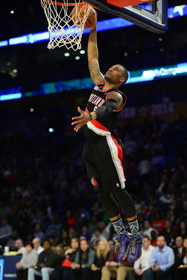 Team Hill guard Damian Lillard dunks for two of his 13 points, but generally took a secondary role. Photo: Bob Donnan, Reuters