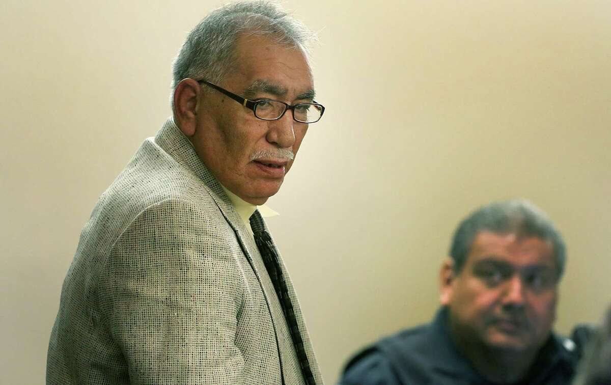 Benito Valverde, left, is on trial for murder, in the 290th District Courtroom at the Cadena-Reeves Justice Center. Tuesday, Feb. 11, 2014.
