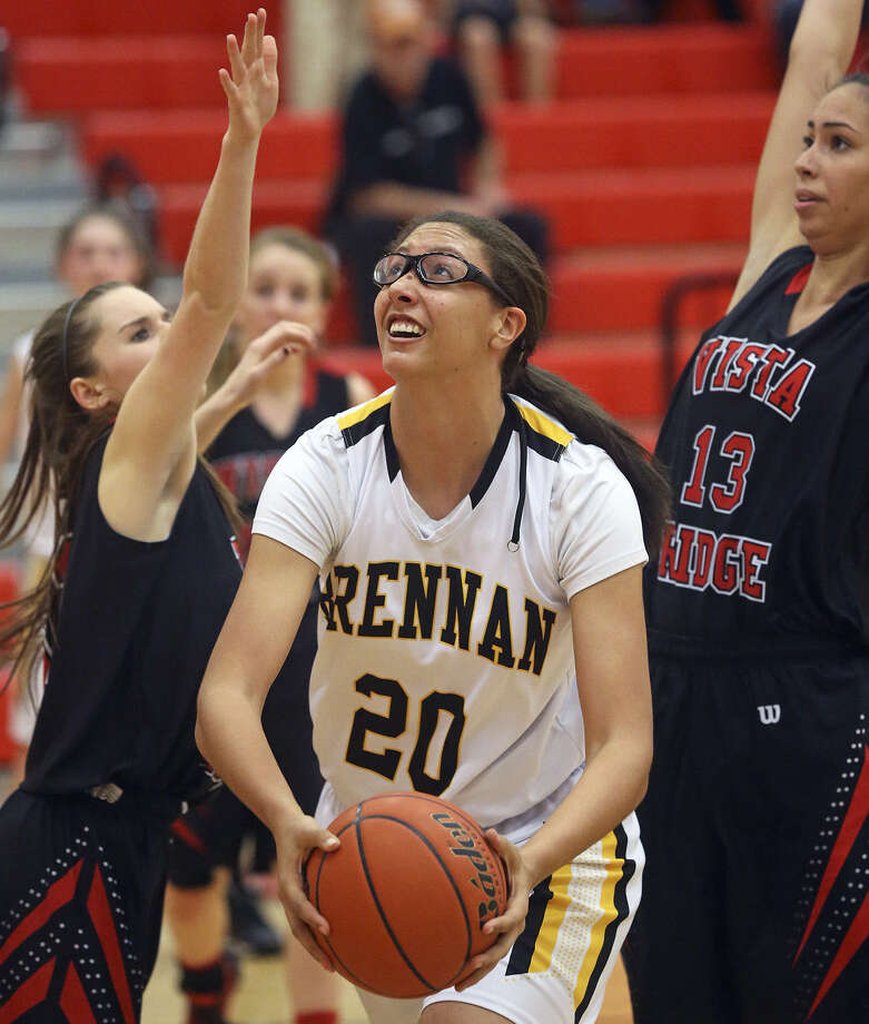 Brennan center Deja Mason pivots under post defenders to convert a layup during a Class 4A second-round game against Cedar Park Vista Ridge. Mason had eight points off the bench. Photo: Photos: Tom Reel / San Antonio Express-News
