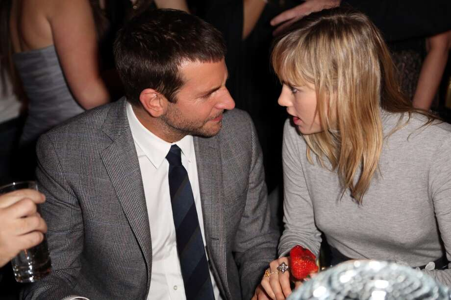 """Bradley Cooper (L) and Suki Waterhouse attend Grey Goose Vodka and Vanity Fair present in part the world premiere of  """"American Hustle"""" at Ziegfeld Theater on December 8, 2013 in New York City. Photo: Monica Schipper, Getty Images For Grey Goose"""