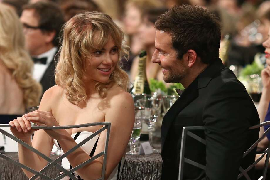 Actor Bradley Cooper (R) and model Suki Waterhouse attend 20th Annual Screen Actors Guild Awards at The Shrine Auditorium on January 18, 2014 in Hollywood, California. Photo: Christopher Polk, WireImage