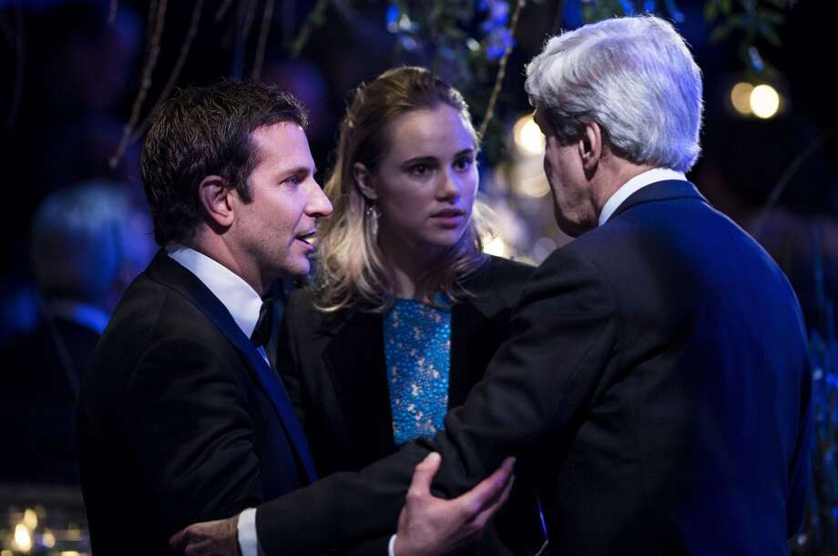 Actor Bradley Cooper (L) and Suki Waterhouse (C) talk with US Secretary of State John Kerry during a State Dinner at the White House February 11, 2014 in Washington, DC. Photo: BRENDAN SMIALOWSKI, AFP/Getty Images