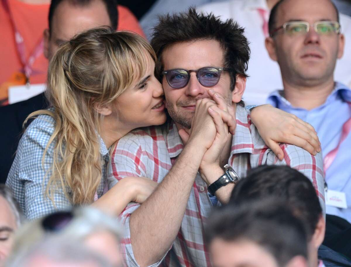 Suki Waterhouse and Bradley Cooper attend the Jerzy Janowicz vs Andy Murray match at the Wimbledon Lawn Tennis Championships on July 5, 2013 in London, England.