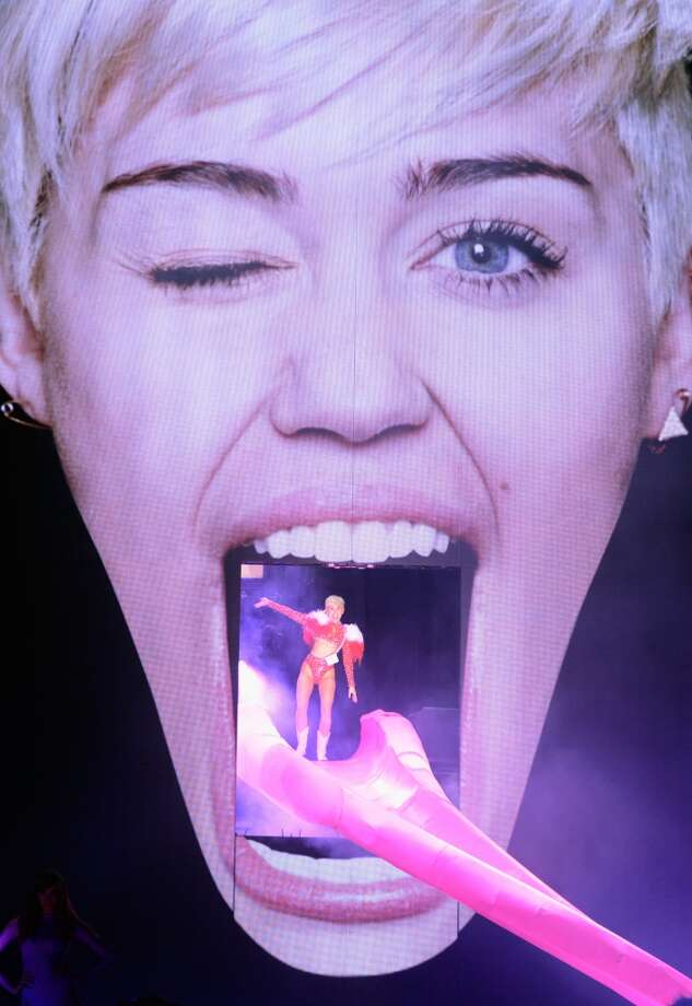 "Miley Cyrus enters the stage on a replica of her own tongue during her ""Bangerz"" tour at Rogers Arena on February 14, 2014 in Vancouver, Canada. Photo: Kevin Mazur, WireImage"