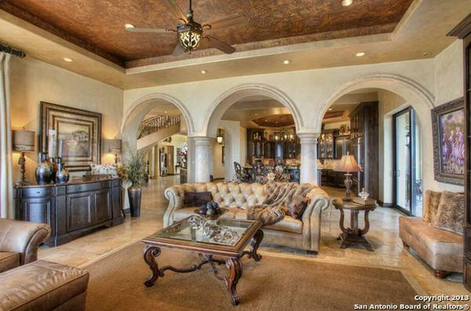 Perched upon the precipice of a majestic hilltop with views for miles, 