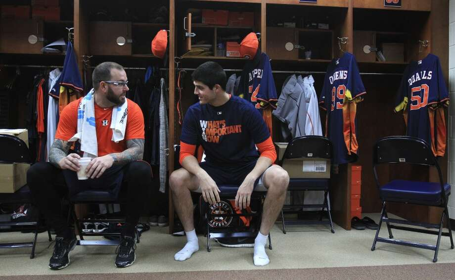 Astros pitchers Peter Moylan (left) speaks with Mark Appel. Photo: Karen Warren, Houston Chronicle