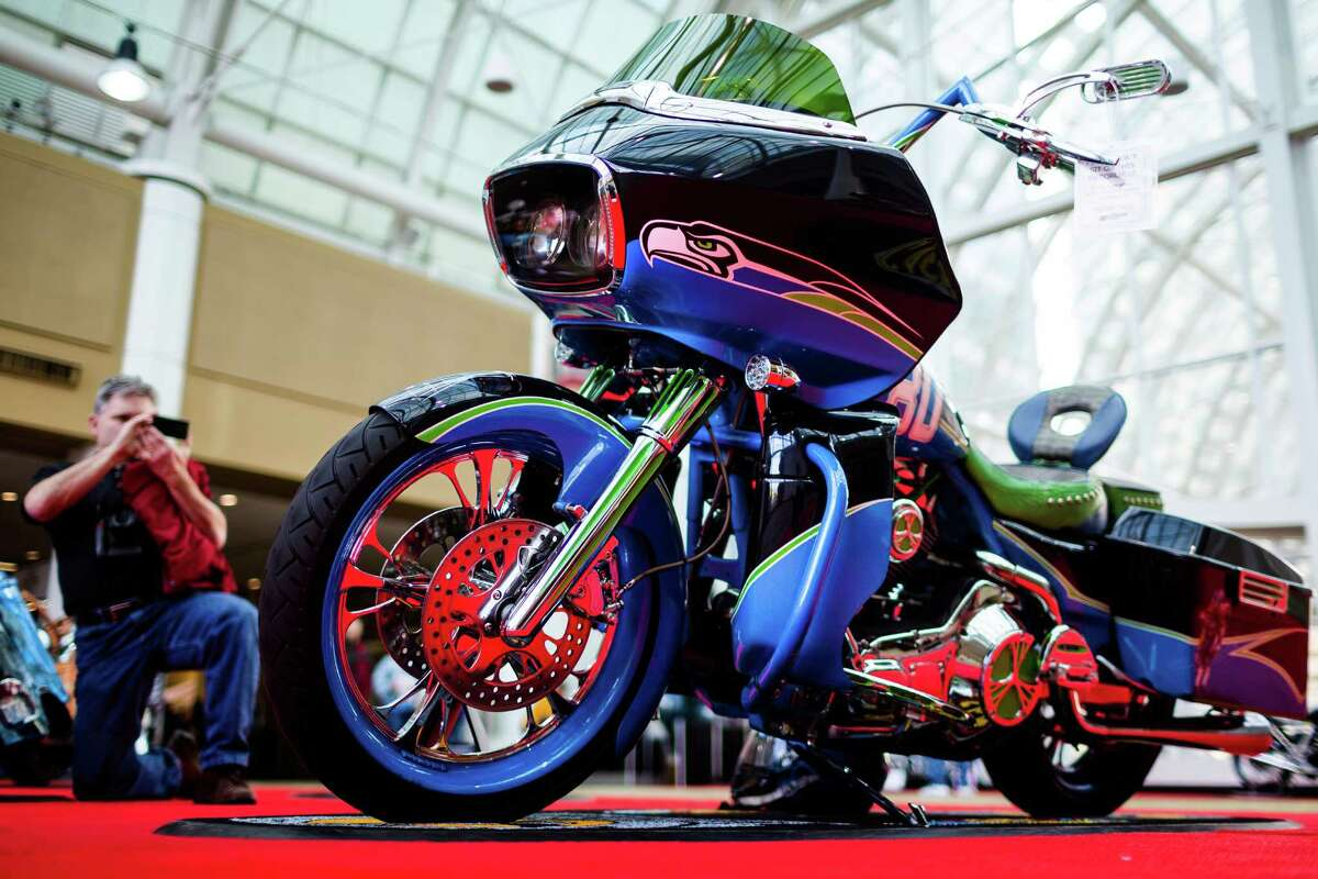 A Seahawks-styled bike sits on display alongside vintage, modern, three-wheeled and custom-designed bikes of all colors and sizes at the Progressive International Motorcycle Show Friday, Feb. 14, 2014, at the Washington State Convention Center in Seattle. The event - which runs through Sunday - also featured live music, builder competitions and celebrity appearances.