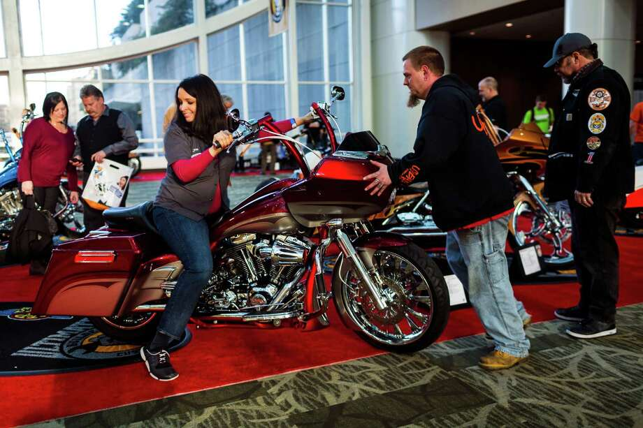 Exhibitors roll in bikes for the Progressive International Motorcycle Show Friday, Feb. 14, 2014, at the Washington State Convention Center in Seattle. The event - which runs through Sunday - also featured live music, builder competitions and celebrity appearances. Photo: JORDAN STEAD, SEATTLEPI.COM / SEATTLEPI.COM
