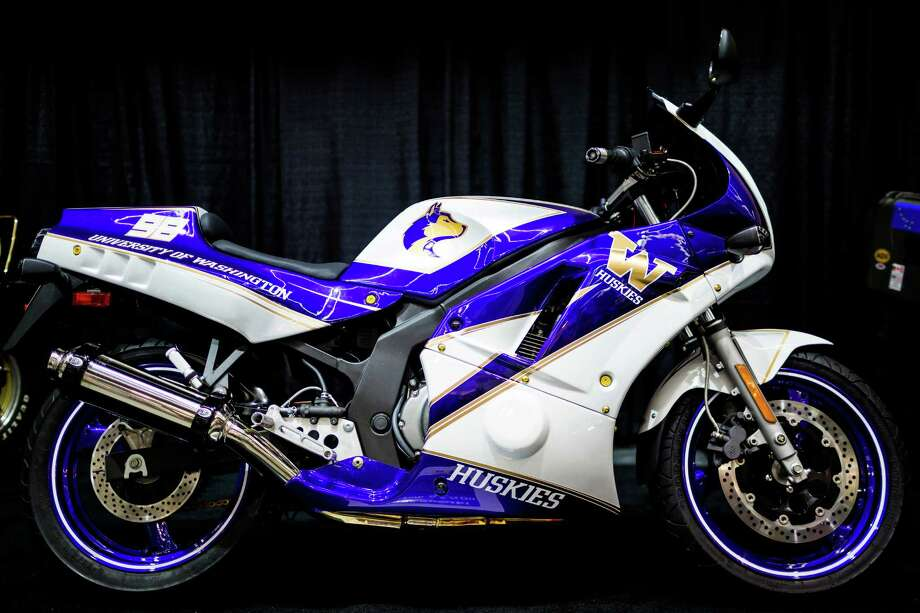 A University of Washington-styled bike sits on display at the Progressive International Motorcycle Show Friday, Feb. 14, 2014, at the Washington State Convention Center in Seattle. The event - which runs through Sunday - also featured live music, builder competitions and celebrity appearances. Photo: JORDAN STEAD, SEATTLEPI.COM / SEATTLEPI.COM