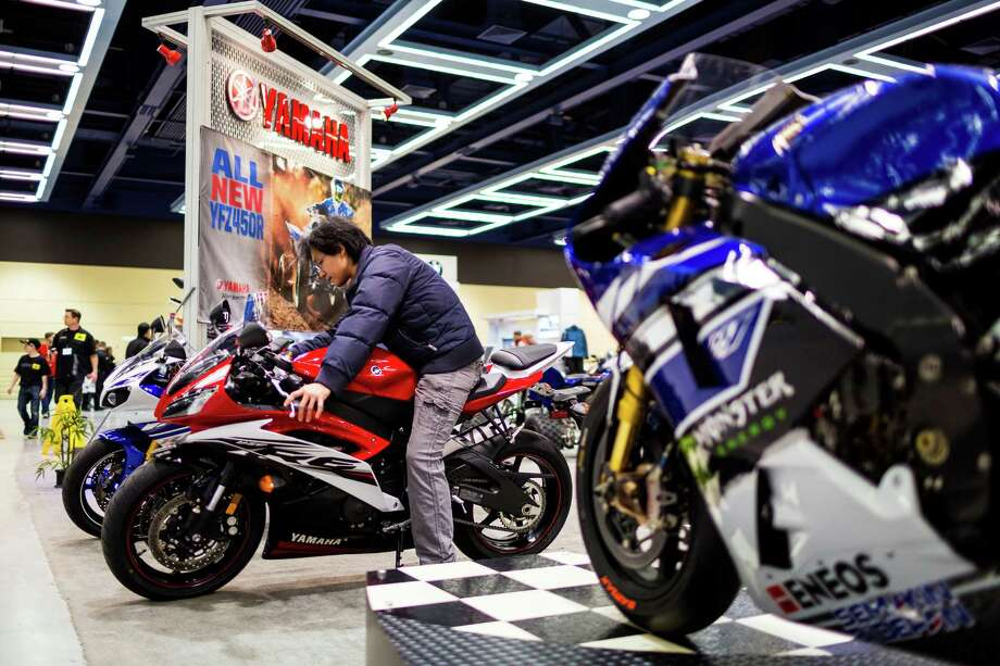 Attendees threw a leg over bikes of all colors and sizes on display at the Progressive International Motorcycle Show Friday, Feb. 14, 2014, at the Washington State Convention Center in Seattle. The event - which runs through Sunday - also featured live music, builder competitions and celebrity appearances. Photo: JORDAN STEAD, SEATTLEPI.COM / SEATTLEPI.COM