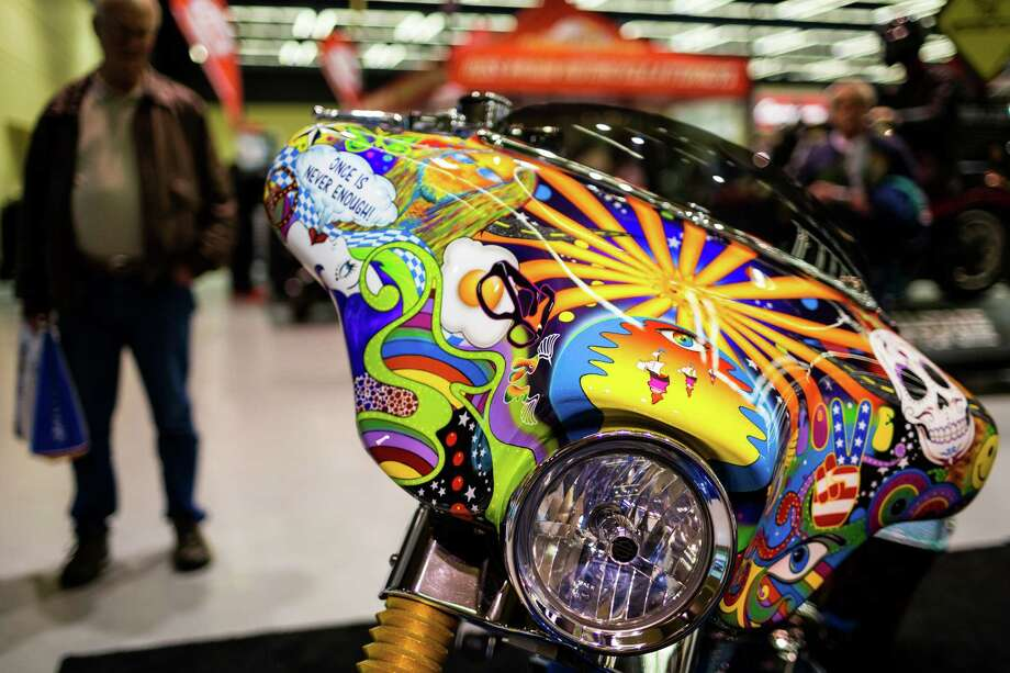Light catches the subtle custom designs on bikes of all colors and sizes on display at the Progressive International Motorcycle Show Friday, Feb. 14, 2014, at the Washington State Convention Center in Seattle. The event - which runs through Sunday - also featured live music, builder competitions and celebrity appearances. Photo: JORDAN STEAD, SEATTLEPI.COM / SEATTLEPI.COM