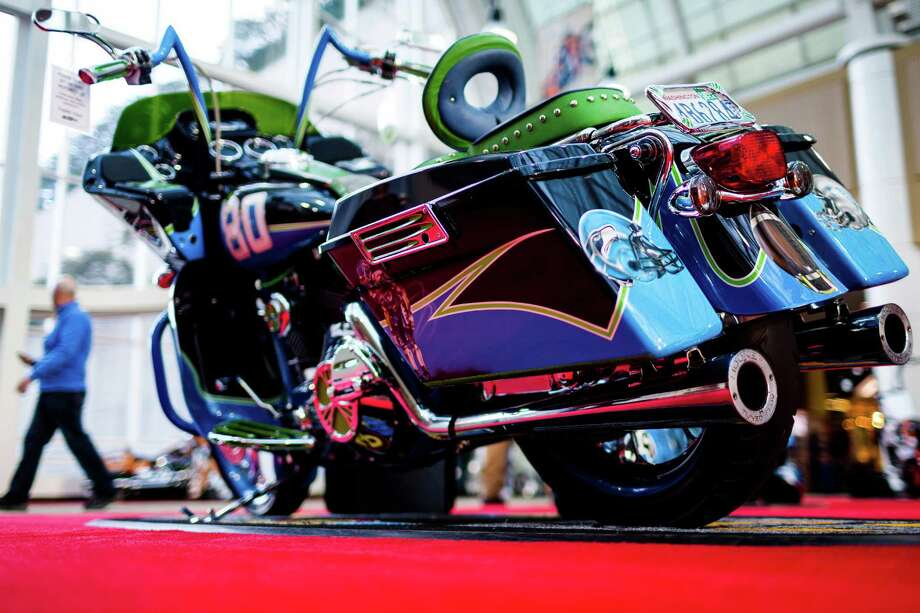 A Seahawks-styled bike sits on display alongside vintage, modern, three-wheeled and custom-designed bikes of all colors and sizes at the Progressive International Motorcycle Show Friday, Feb. 14, 2014, at the Washington State Convention Center in Seattle. The event - which runs through Sunday - also featured live music, builder competitions and celebrity appearances. Photo: JORDAN STEAD, SEATTLEPI.COM / SEATTLEPI.COM