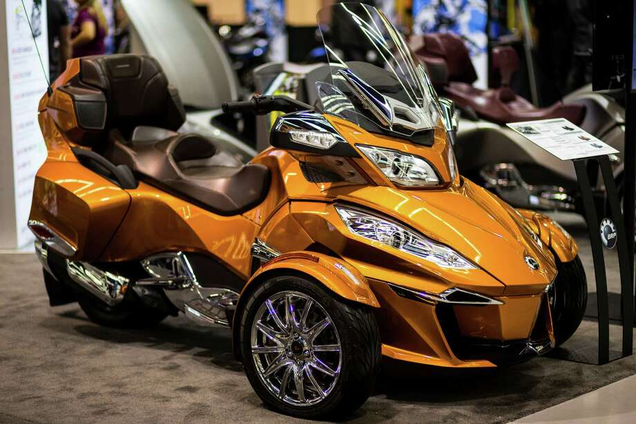 Three-wheeled bikes of all colors and sizes on display at the Progressive International Motorcycle Show Friday, Feb. 14, 2014, at the Washington State Convention Center in Seattle. The event - which runs through Sunday - also featured live music, builder competitions and celebrity appearances. Photo: JORDAN STEAD, SEATTLEPI.COM / SEATTLEPI.COM