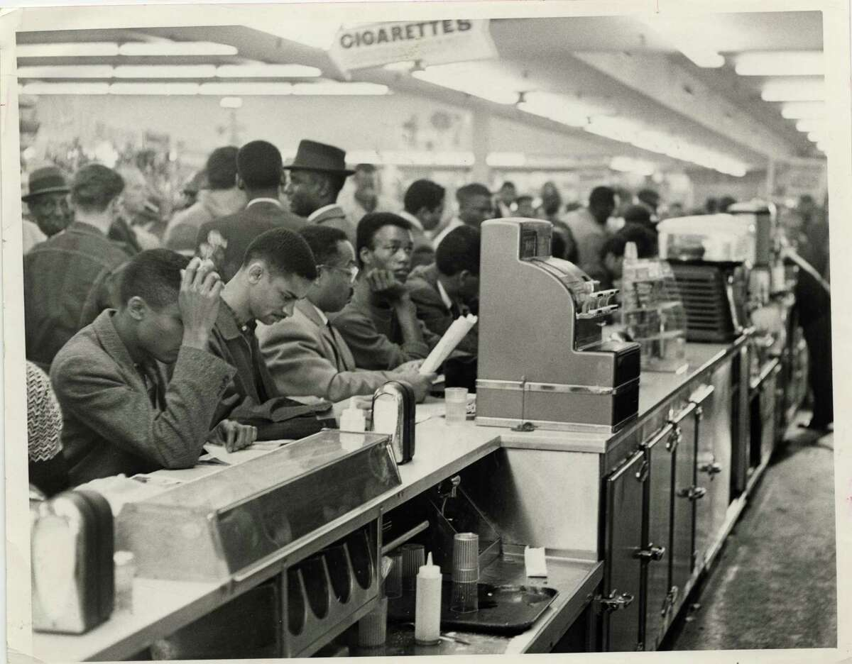 Student demonstrators, members of the Progressive Youth Association, sit down in protest at a white lunch counter at Weingarten's No. 26, 4110 Almeda, Houston, on March 4, 1960. The students, mostly from TSU, occupied all 30 stools at Weingarten's lunch counter.