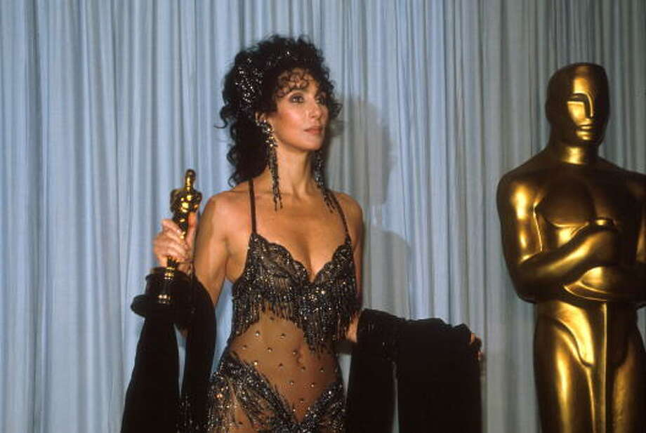 Cher holds her Oscar at the Academy Awards April 11, 1988.  She won for MOONSTRUCK. Holly Hunter should have won that year for BROADCAST NEWS. Photo: Marc Biggins, Getty Images / Hulton Archive