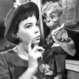 French actress Leslie Caron in the title role of 'Gigi', directed by Vincente Minnelli, 1958.  Charming, the best of the films nominated, but . . . how about VERTIGO, which wasn't nominated?