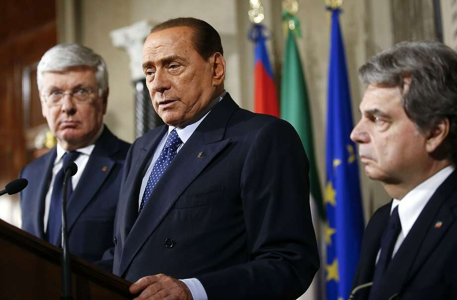 Silvio Berlusconi (center), former premier and leader of Forza Italia party, tells reporters what his party's role will be in any new government that is formed. Photo: Tony Gentile, Reuters