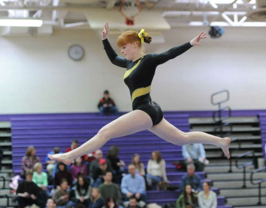 Tara Oliver of Trumbull High School on the balance beam during the FCIAC Gymnastics championships at Westhill High School, Stamford, Conn., Saturday, Feb. 15, 2014. Photo: Bob Luckey / Greenwich Time