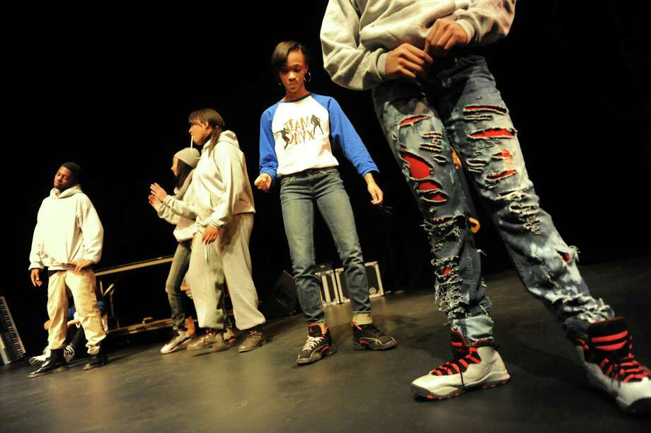 Team Onyx, an Albany-based hip hop troupe, runs through their routine before performing for the Black and Puerto Rican Caucus Youth Summit on Saturday, Feb. 15, 2014, at The Egg in Albany, N.Y. The dancers practice Monday through Friday nights at the Arbor Hill Community Center. (Cindy Schultz / Times Union) Photo: Cindy Schultz / 00025768A
