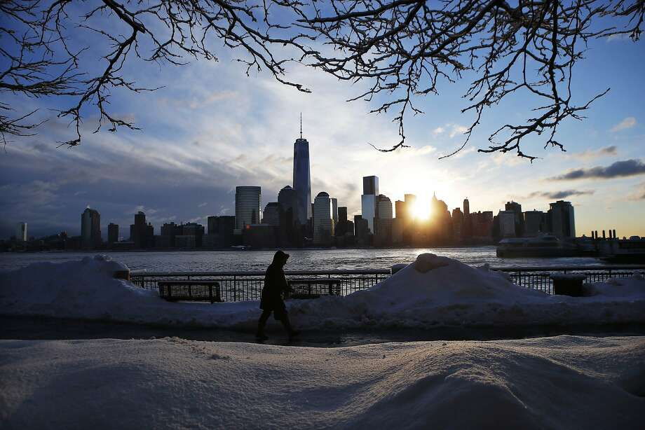 The New York City skyline rises behind a commuter in New Jersey on Friday. The Northeast is expecting another big storm, just on the heels of the last one. Photo: Eduardo Munoz, Reuters